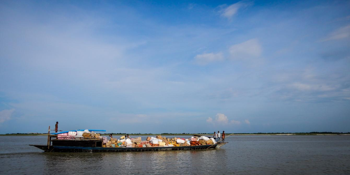 A small mechanized boat carries local trade commodities in Dhubri, Assam. Photo: Sailendra Yashwant/ Oxfam India