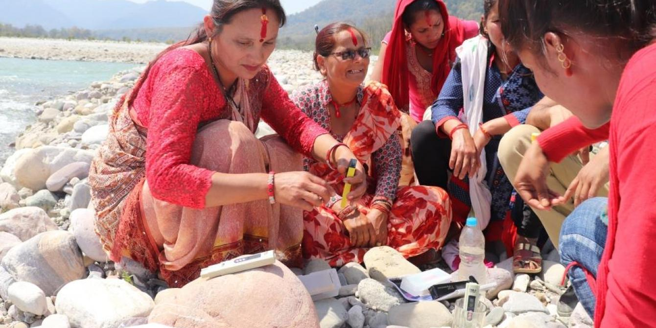 Local women from TROSA supported Women Empowerment Centers (WECs) test the water quality of the Mahakali river in far-western Nepal. Photo: Kamal Rawal RUWDUC Nepal