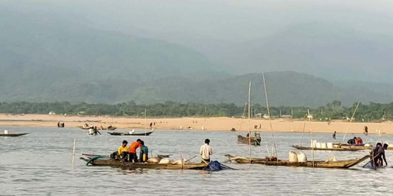 Labourers lifting sands from Jadukatha river in Sunajgonj. Backdrop: Meghalaya hills upstream.
