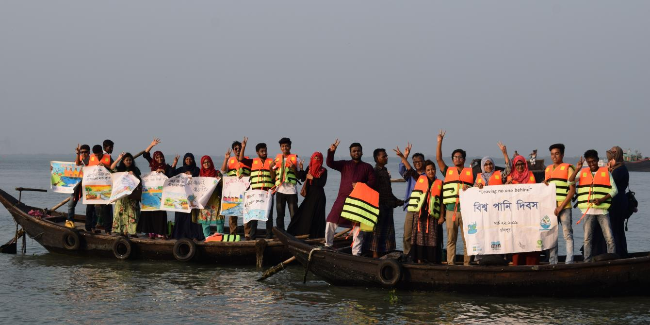 Youths celebrate the World Water Day in Chandpur, Bangladesh. Photo: Masud Al Mamun/ CNRS/Oxfam