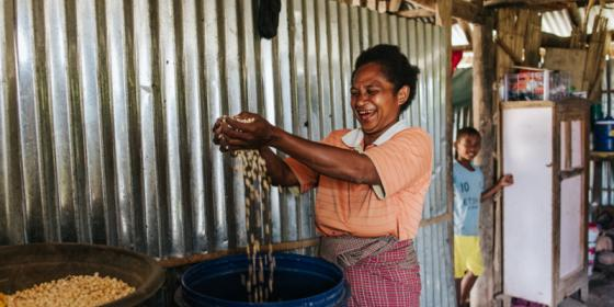 Oecusse, Timor-Leste: Sabina Foni shows her corn harvest that was recently picked from her permanent garden supported by Oxfam's Strengthening Community Livelihoods (Haforsa) Program.