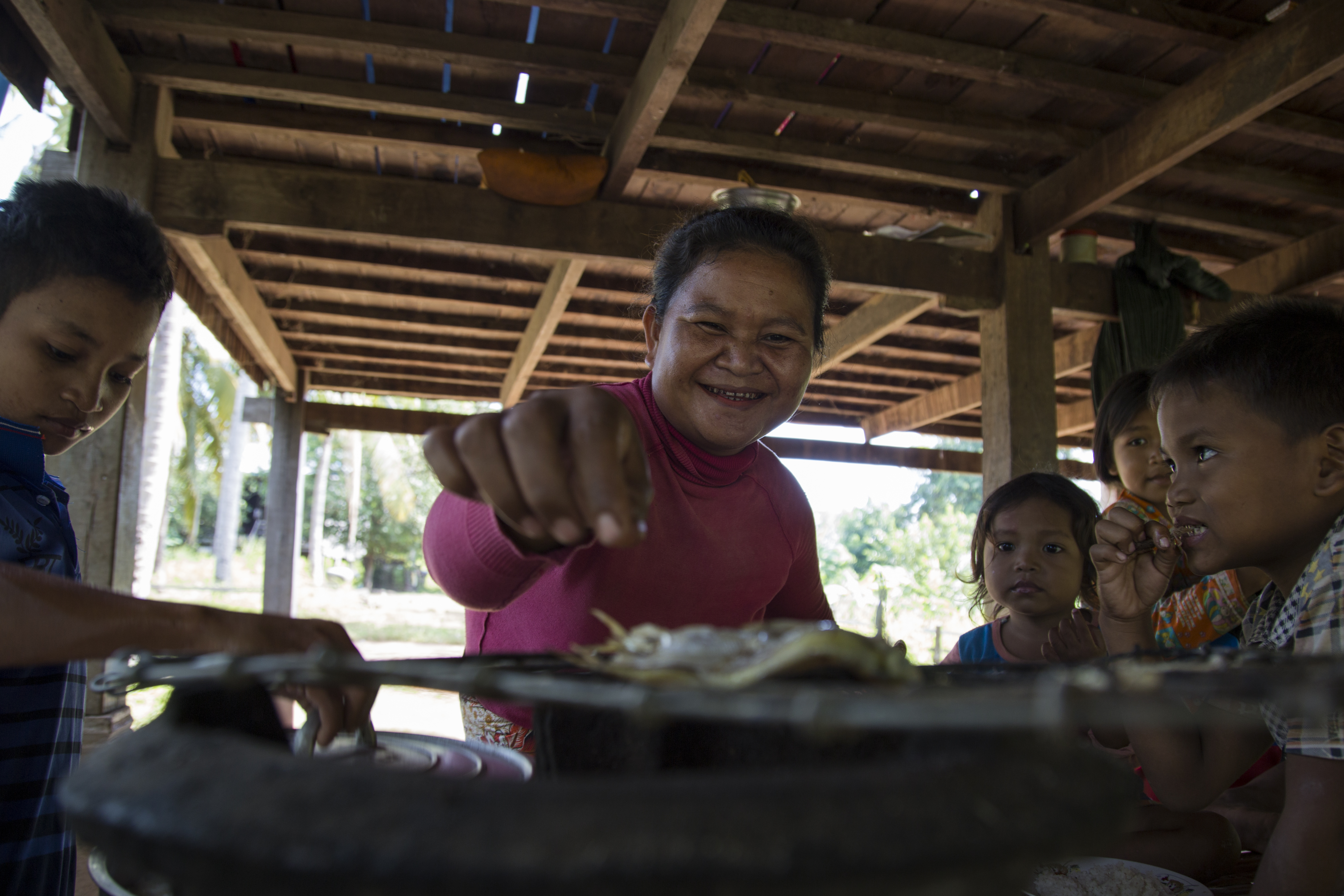 Soth's wife Phun Lai prepare a meal for their children, under their raised home in Koh Khnher village.  Photo by Savann Oeurm/Oxfam