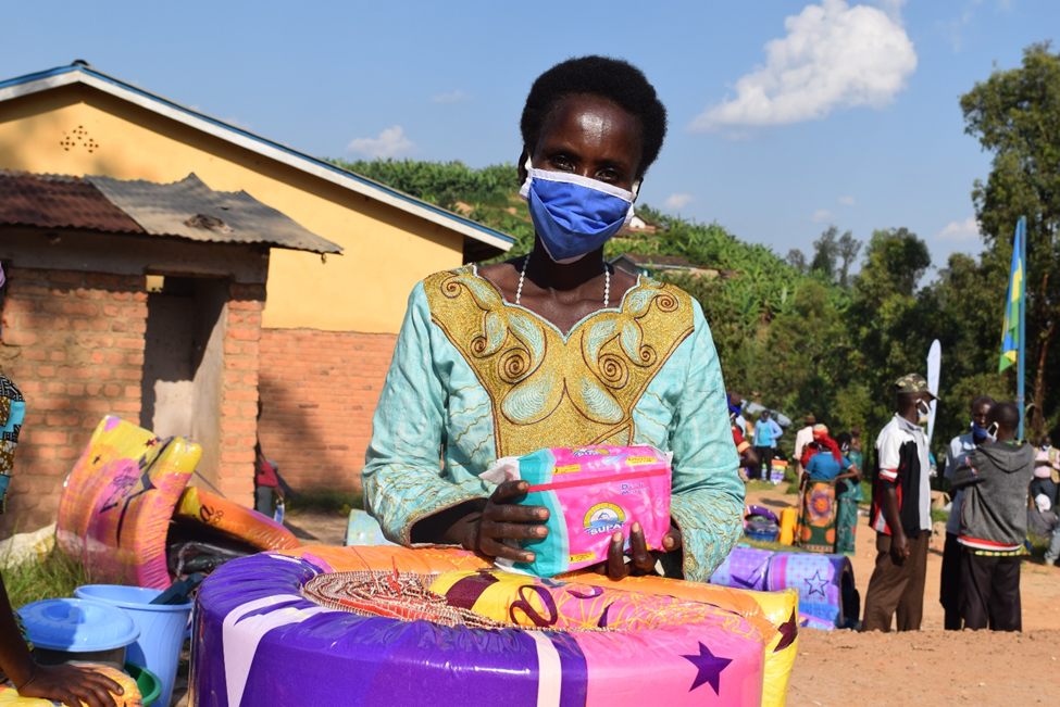 Primitiva Mukagasana receiving lifesaving non-food items including sanitary pads. Photo by Laetitia Umulisa/Oxfam in Rwanda