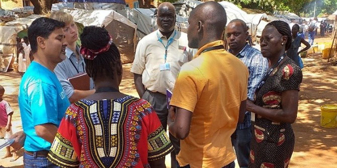 Margaret conversing with partners during a visit to IDP camps in Wau, South Sudan, to support the Ebola preparedness work.