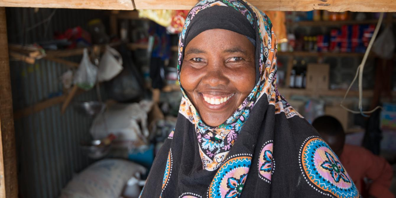 A woman stands outside her shop in Fadhi Gaab area in Somaliland. Allan Gichigi/Oxfam