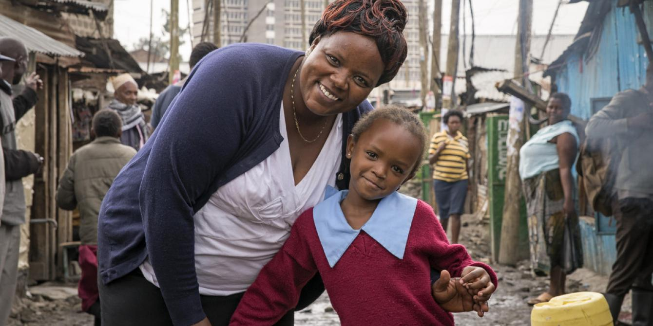 Doreen Muthoni, 38, a small scale trader and her daughter Ruth*, 7. Photo by Katie G. Nelson/Oxfam