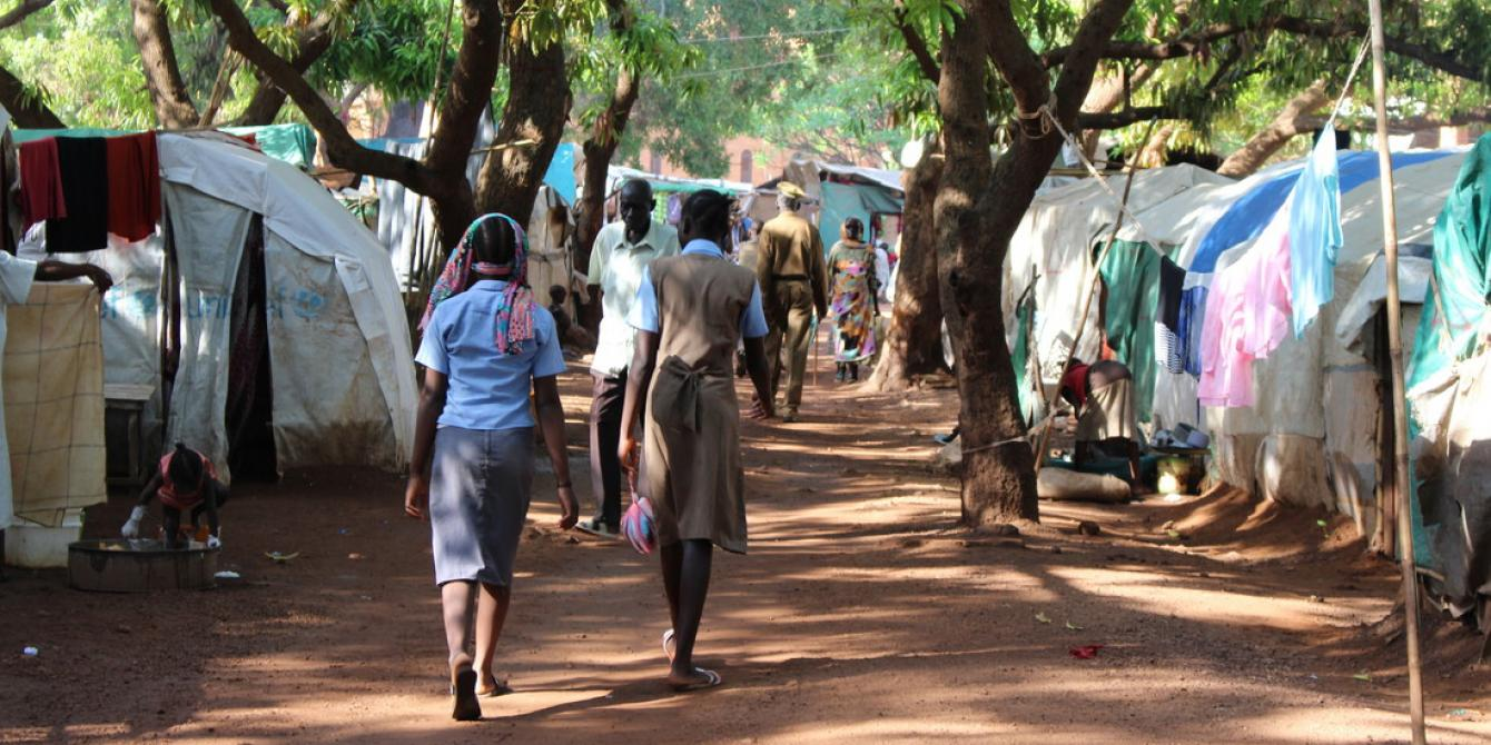 Residents walk through Cathedral camp in Wau, South Sudan. Tim Bierley/Oxfam