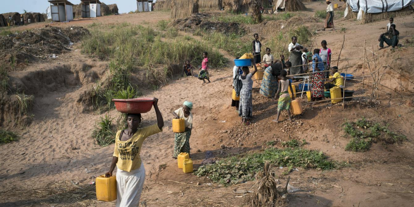 Women collecting water from a tap stand in Kalunga in DRC. Photo by Diana Zeyneb Alhindawi/Oxfam.