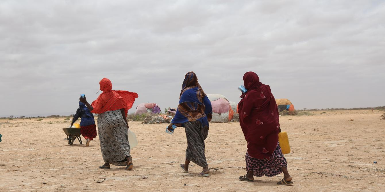 Women collecting water from a water tank in eastern Somaliland. Dustin Barter/Oxfam