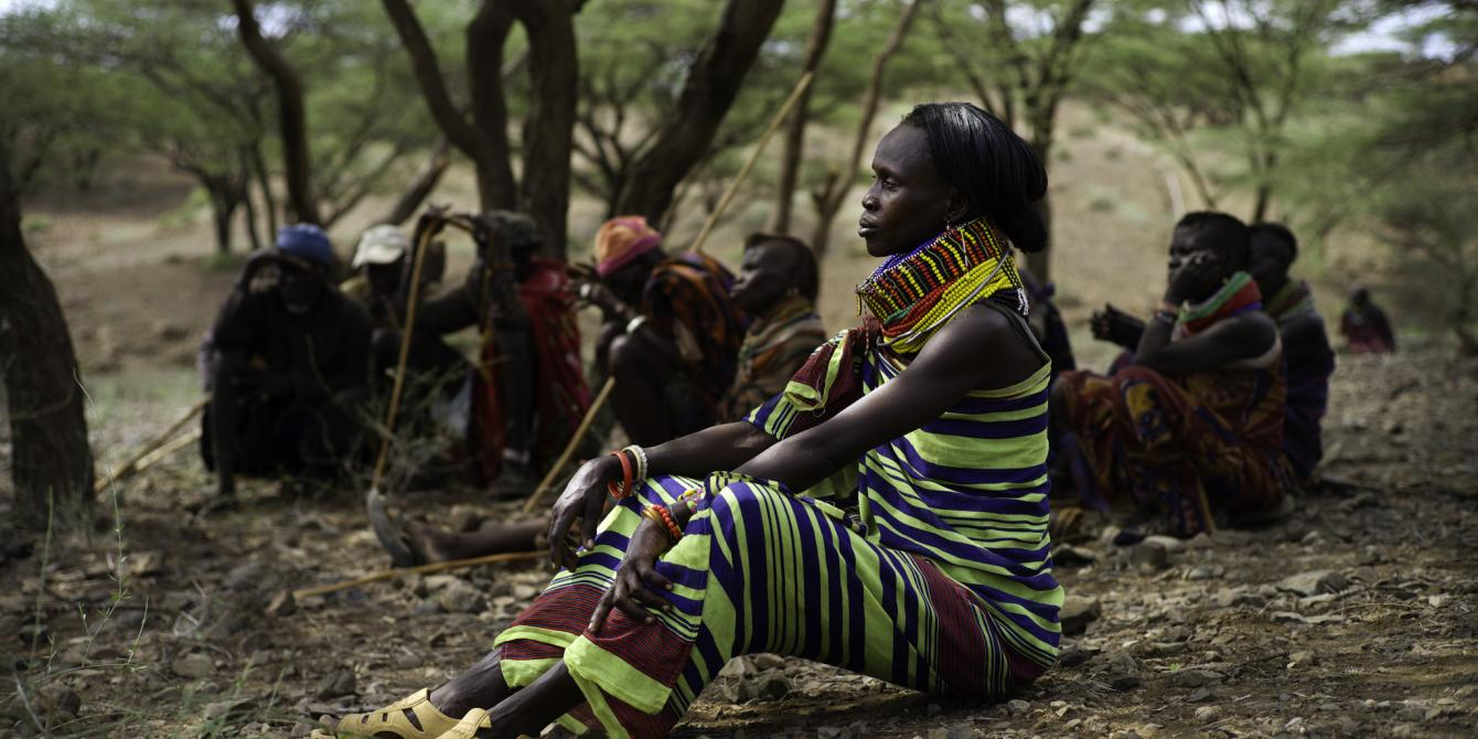 Helen Ewoton (48) sits with other villagers as a drill team bores a hole for fresh water in the village of Nawoyatir in the Lapur district of Lokitaung in Turkana. Kieran Doherty/Oxfam