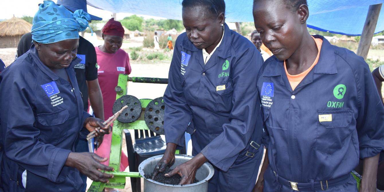Members of Loketa's women's group in Uganda in the briquette-making process.