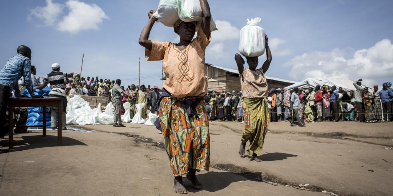 Francoise* (47), collects her first bag of dried food in Bunia, DRC. Photo by John Wessels / Oxfam
