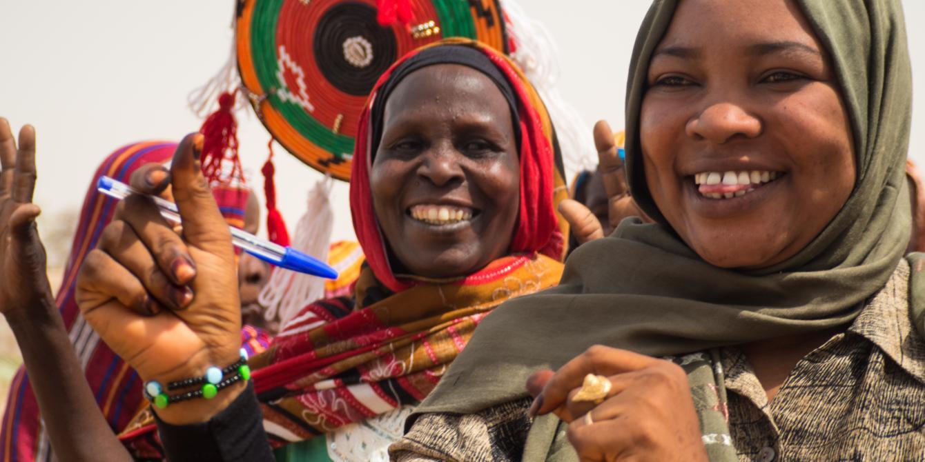 Women celebrating in Sudan. Elizabeth Stevens/Oxfam