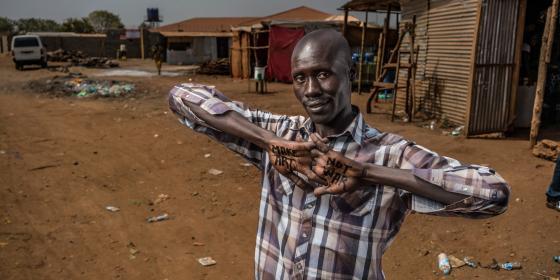 Make peace, not war. Robert Fogarty/Oxfam