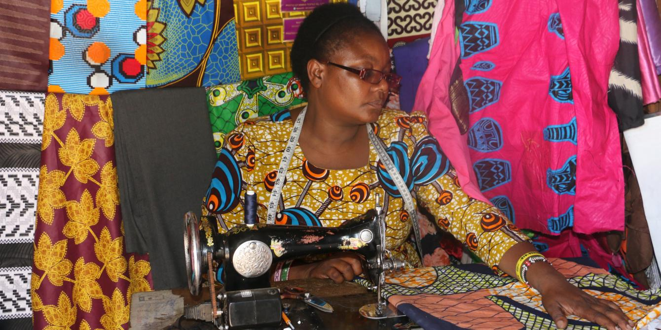 Peris sewing an african dress for a customer.