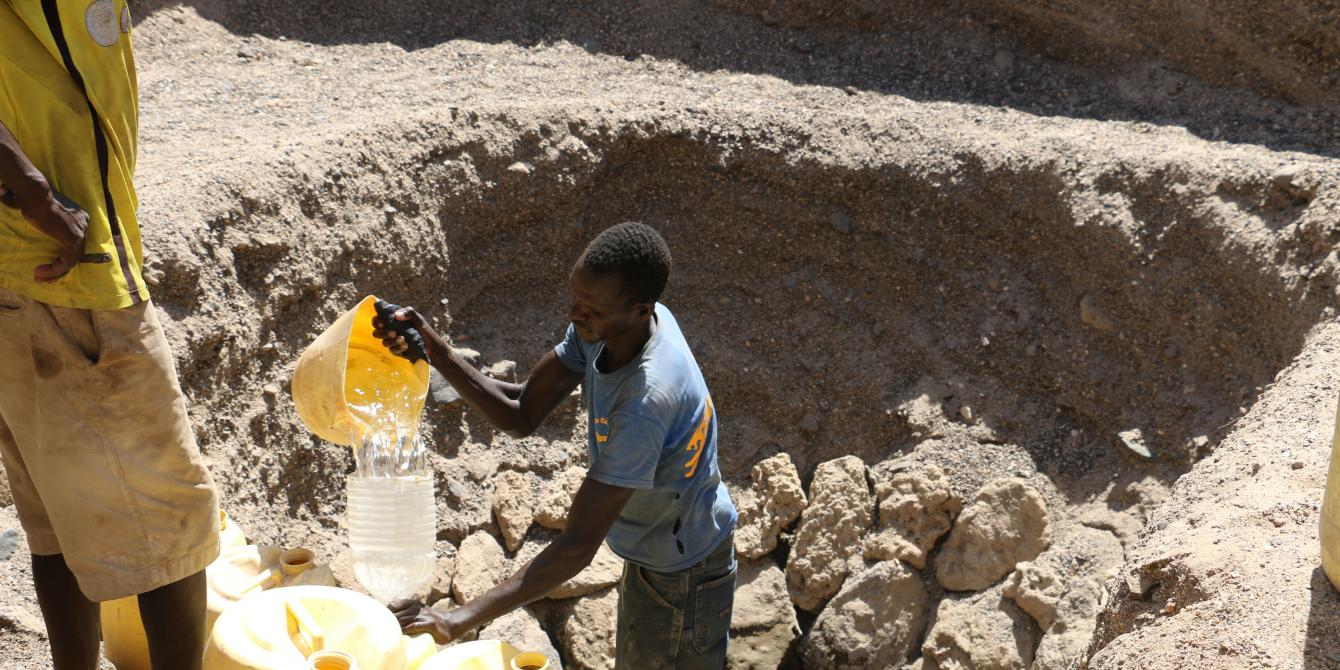 A young man fetching water for sale in drought affected Kalokol area in Turkana. Photo Credit/Joyce Kabue