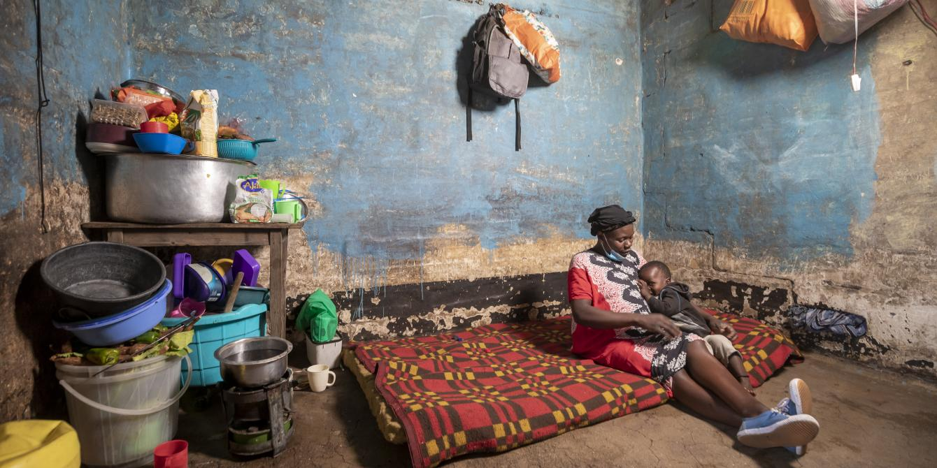 Beatrice Mbendo and her son | Photo by Sven Torfinn |Oxfam Novib