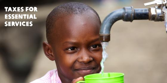 Student from Mukuru Reuben, Nairobi, fetching clean water from a tap at the school bio centre. Photo Credit Abraham Ali