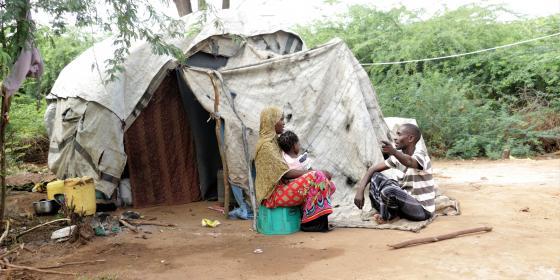 Fatuma Juma, her husband and last born daughter outside their makeshift house. Photo credit/Jeremy Mutiso