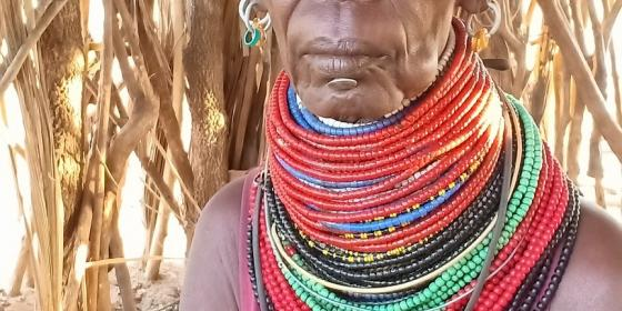 Jalinga Nyakaa sitted inside at her hut.