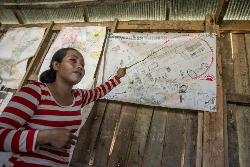 Vanthong explains the village group plan