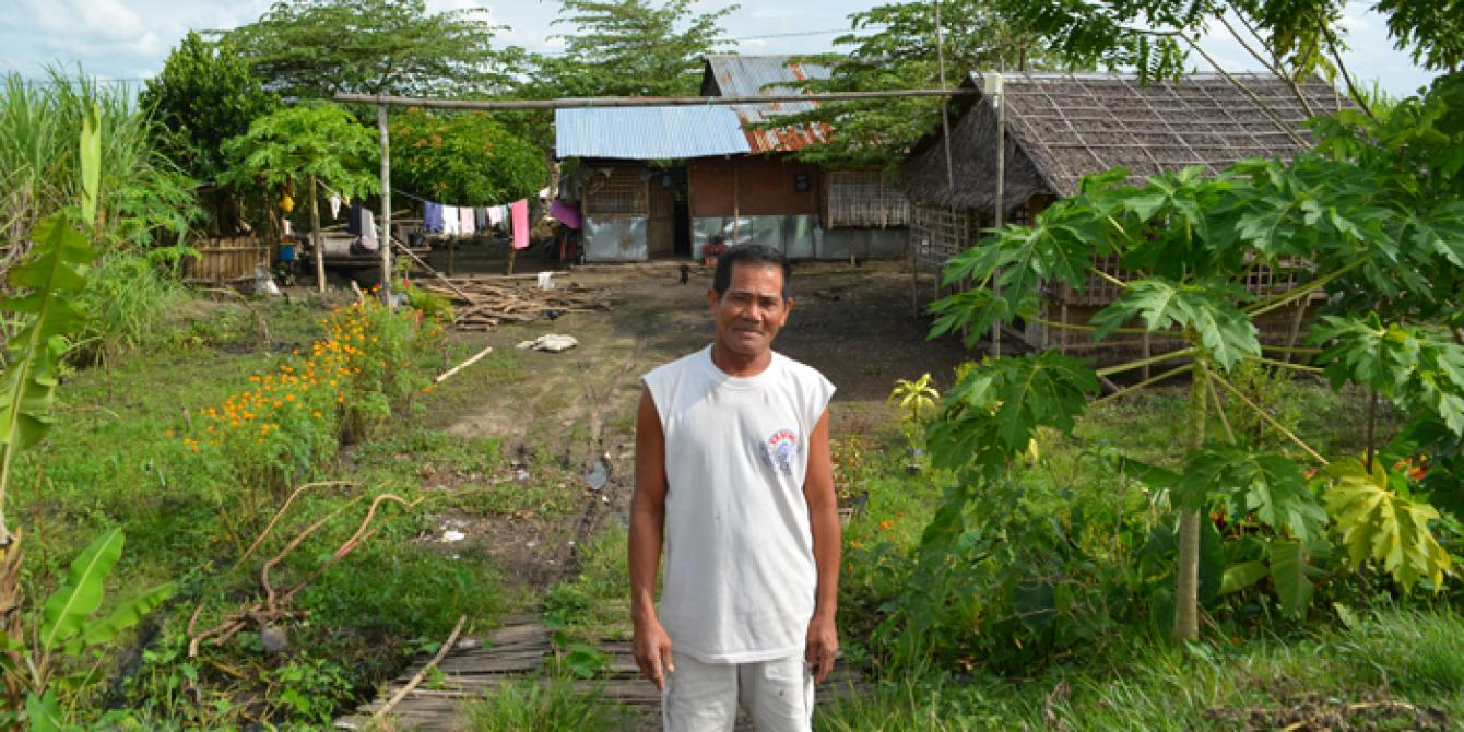 farmer standing in front of his land