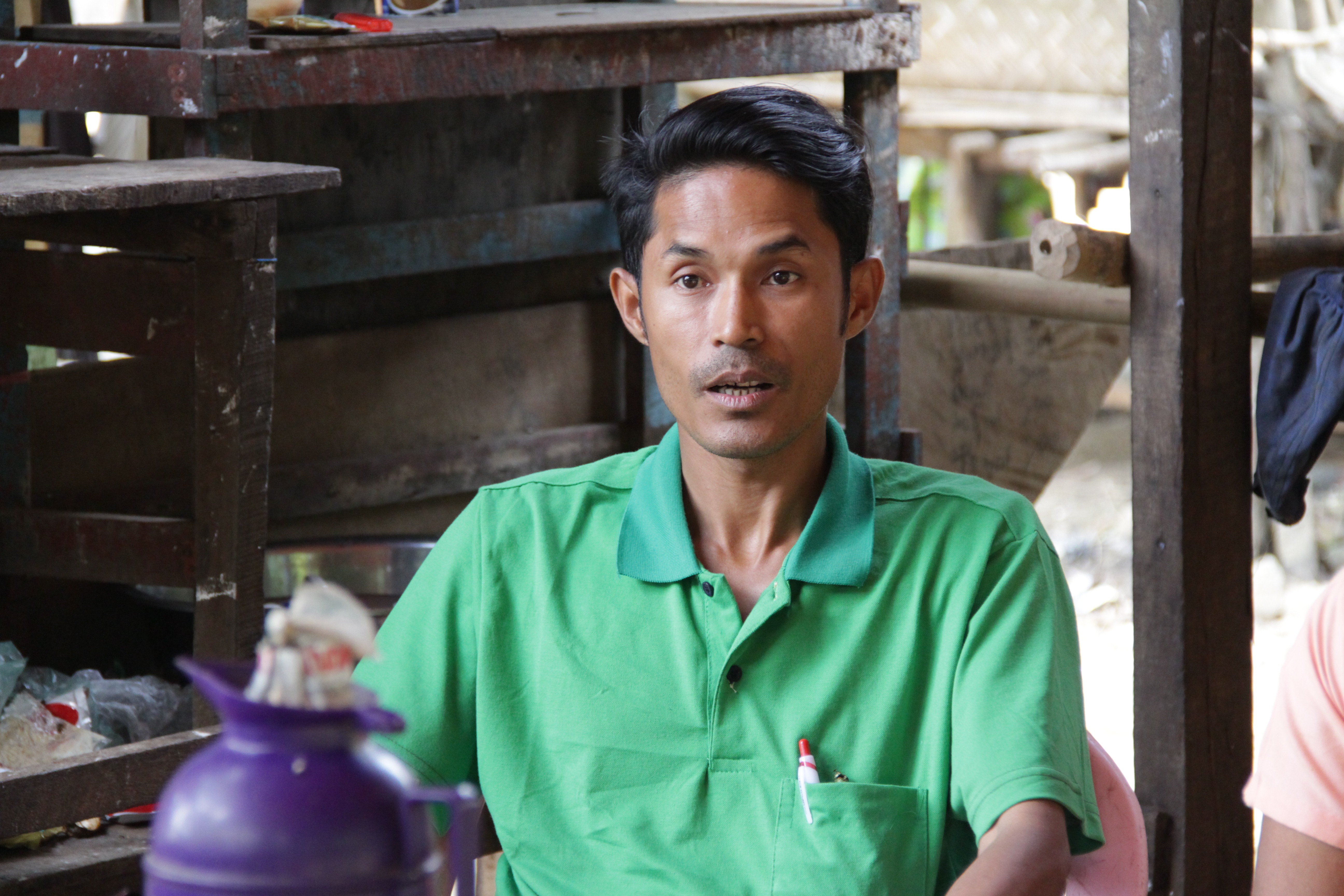 U Kyaw Win, village leader of Thit Pote Taung is sitting on the chair and talking with Oxfam's staff and