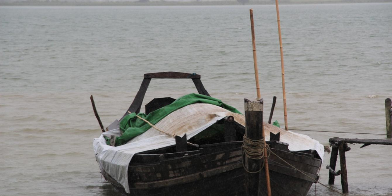 A small fishing boat at the river side in Sittwe, Rakhine State. Photo by: Oxfam