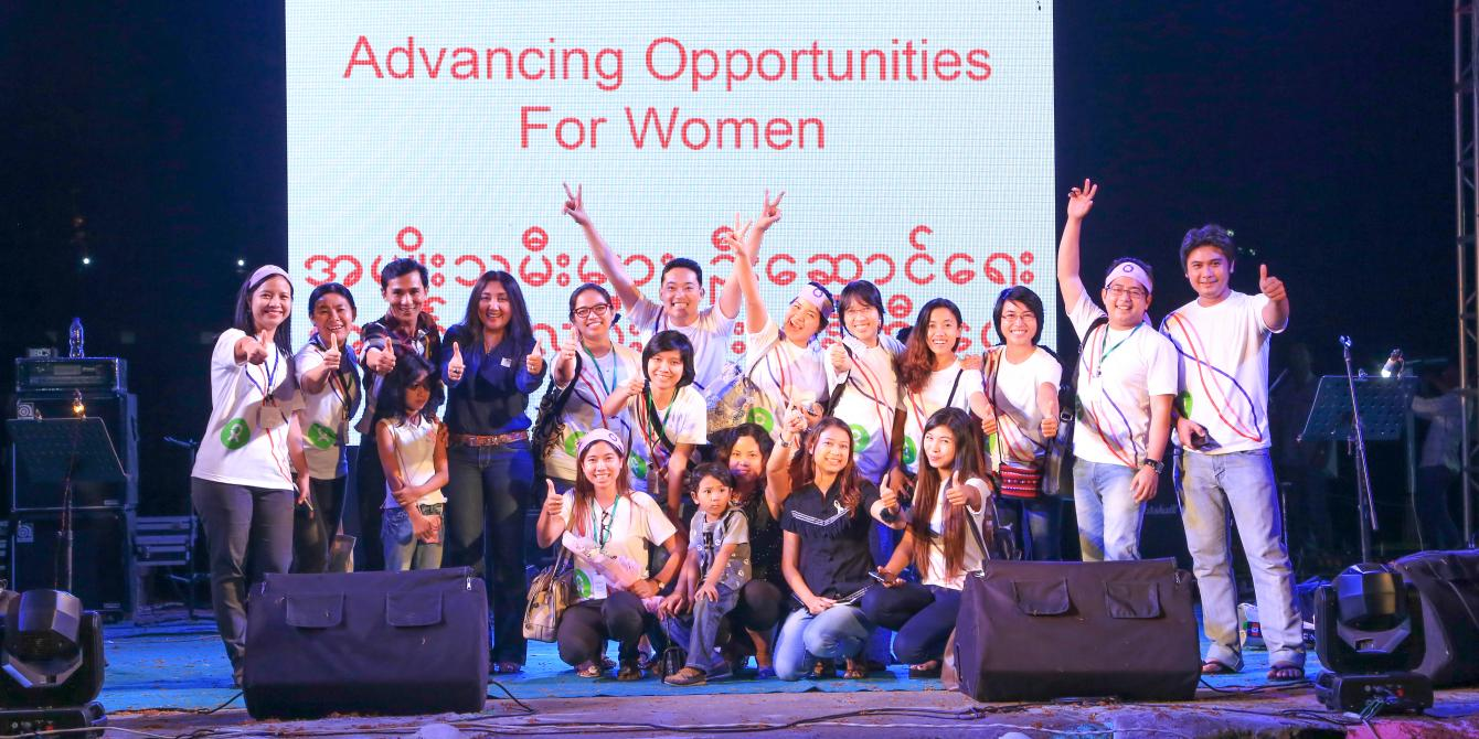 Oxfam Staff and musicians standing together after the music concert, Photo by: Pyae Aye Nyein/Oxfam