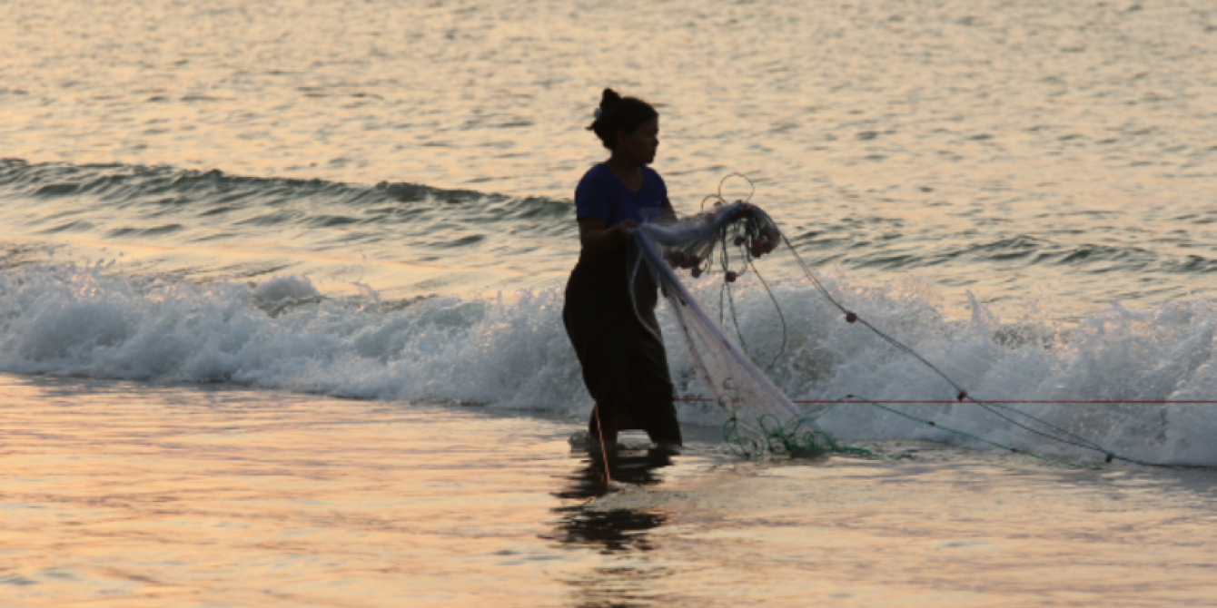 Local Women carrying a fishing net in Kyauk Phyu, Rakhine state
