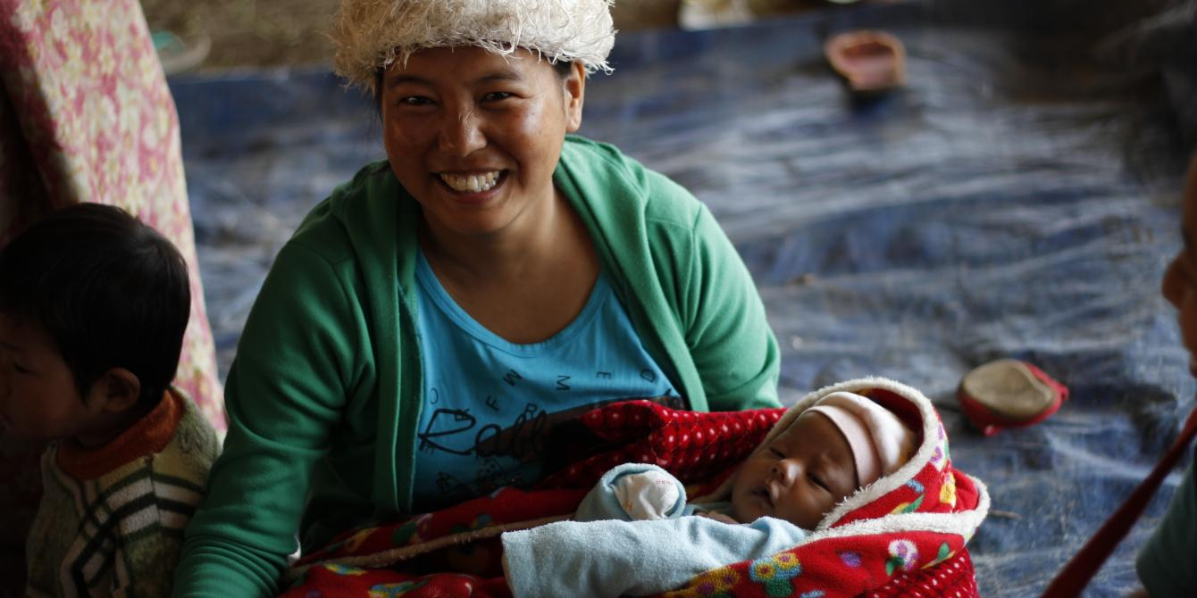 A woman with new born baby in Kachin IDP Camp where Oxfam works for humanitarian response. Photo by: Oxfam