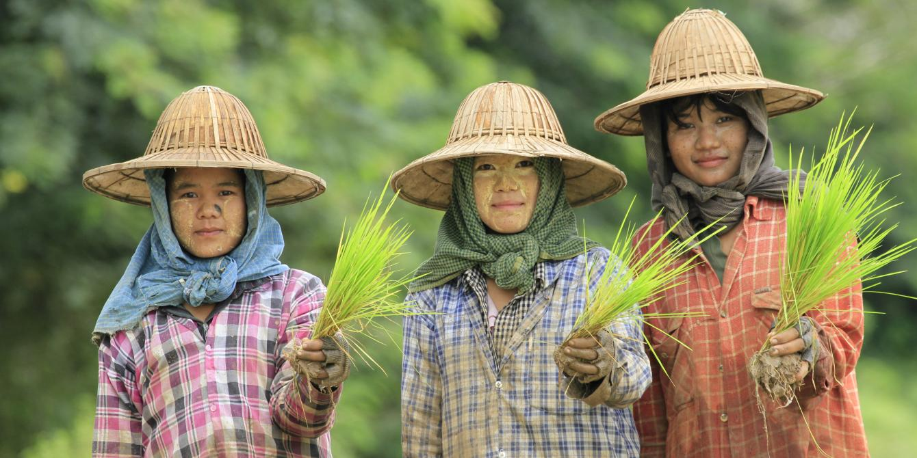 Three young women Farmers in Myanmar's central dryzone in the farms during plantation season. Photo by: Hein Latt Aung/ Oxfam