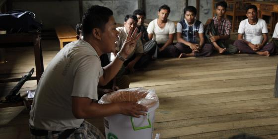 Providing Awareness on how to use mud mater filter for drinking water. Photo by: Oxfam in Myanmar