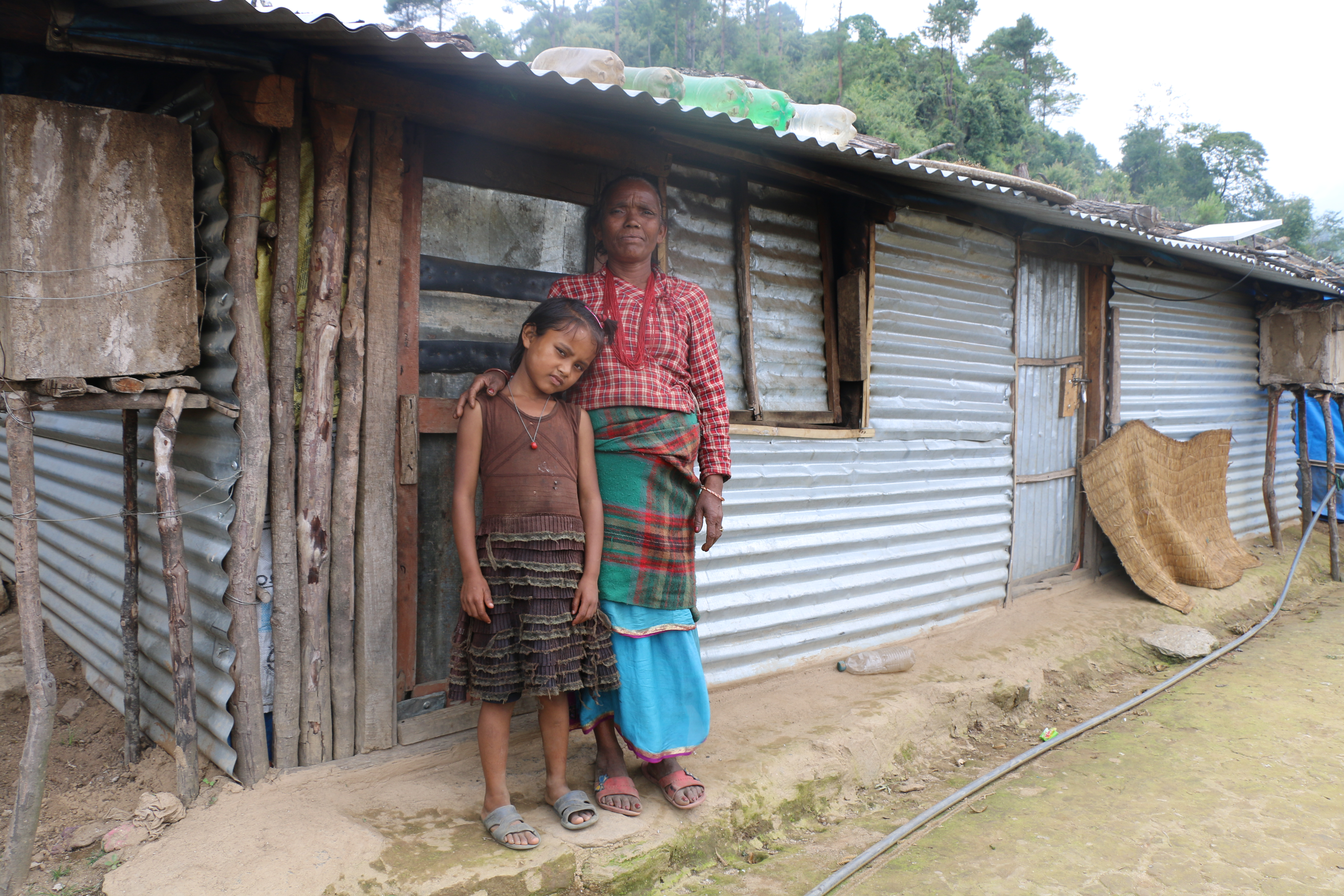 Lati and her grand daughter Sirjana outside their temporary settlement in Selang
