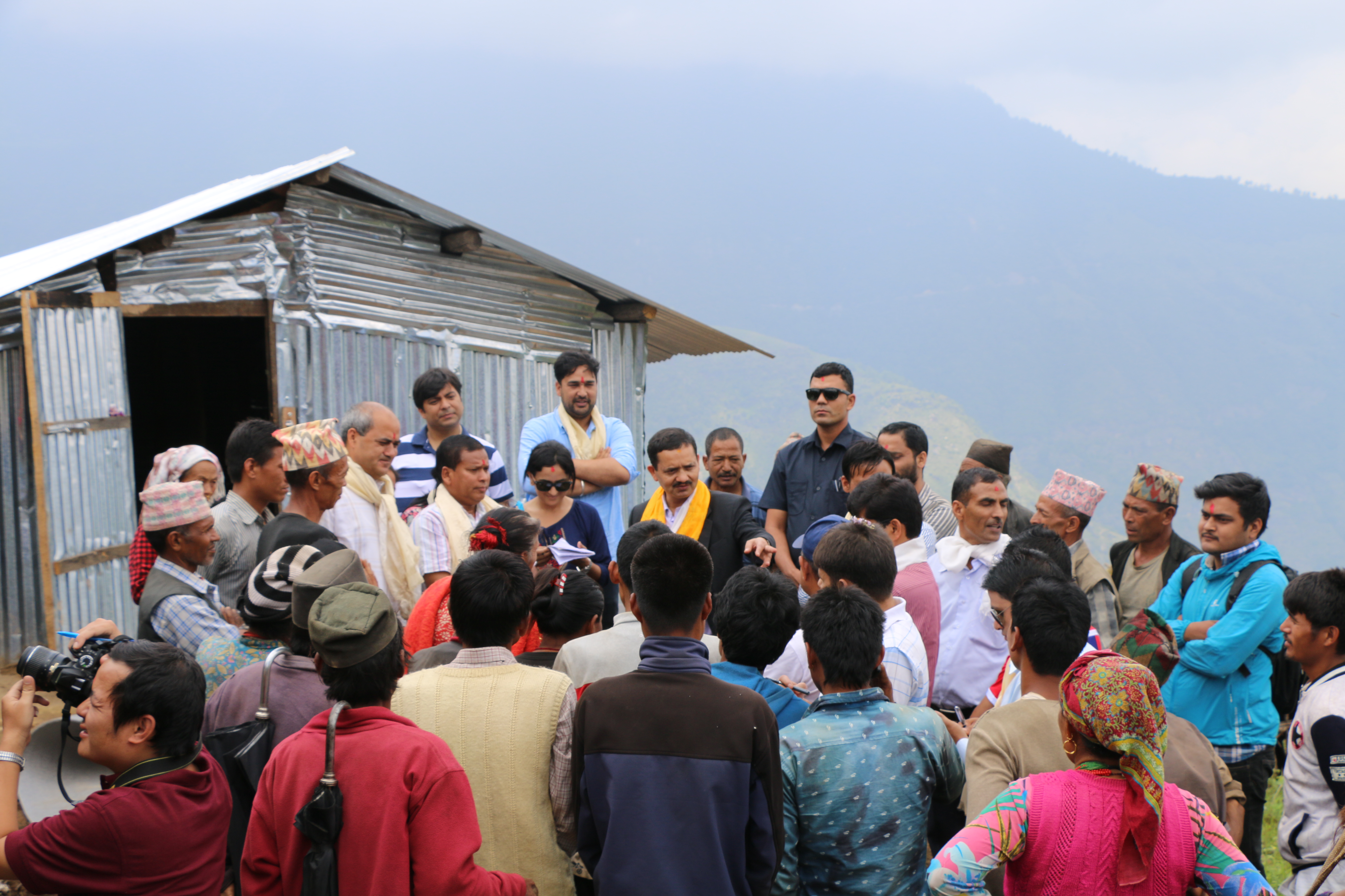 Govinda Pokharel (wearing yellow scarf), Chief Executive Officer of the National Reconstruction Authority interacting with the people displaced by earthquake in Selang, Sindhupalchowk