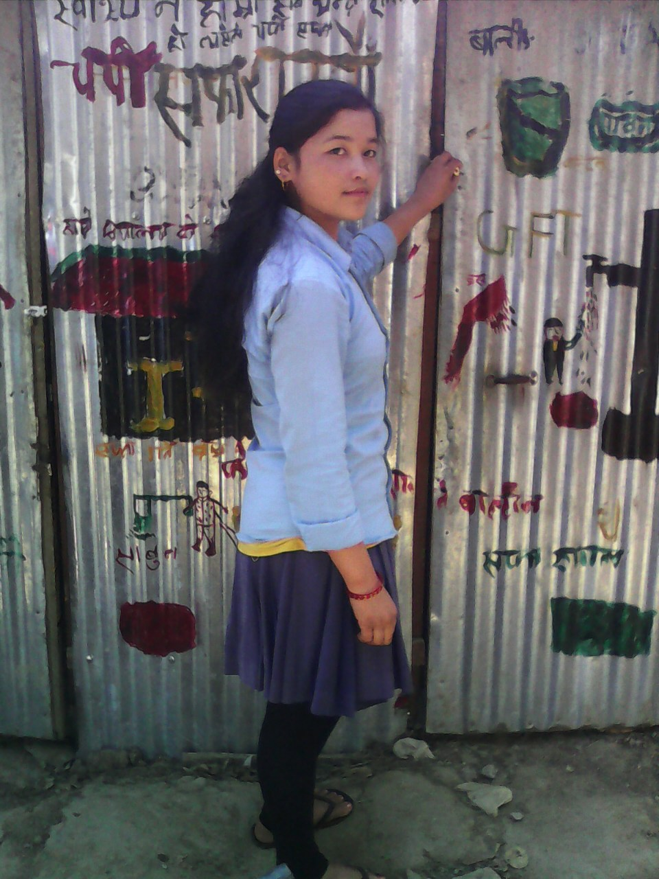 Samjhana in front of the female friendly toilet - Credit Sushmita Acharya/Oxfam.jpg