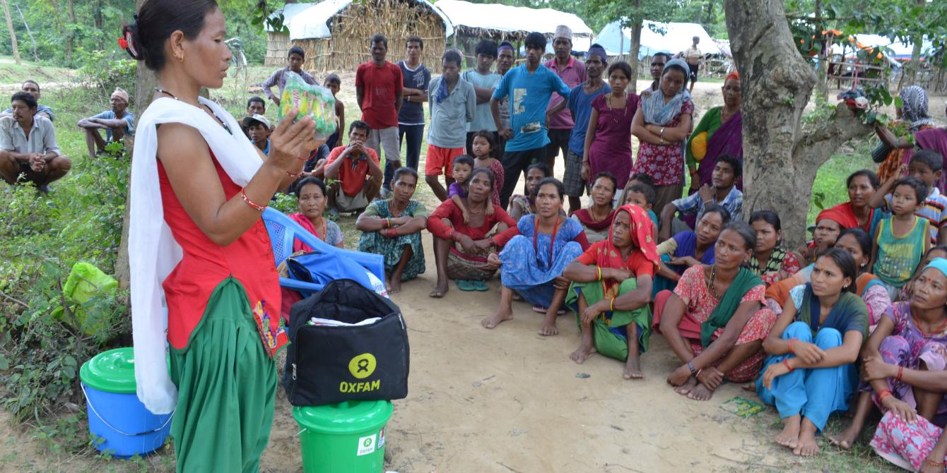 Oxfam staff teach community members how to cope with disasters such as flooding - DRR team/Oxfam