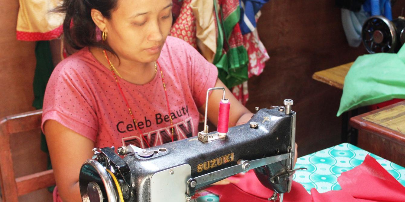 Padma Gurung sewing sanitary napkins at her tailoring shop. Photo by: Sabir Ojha/Oxfam