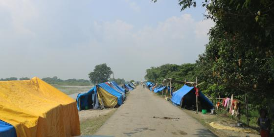 Temporary shelters set up people whose houses were damaged by the floods in Dalwa of Rampur Malhaniya in Saptari district