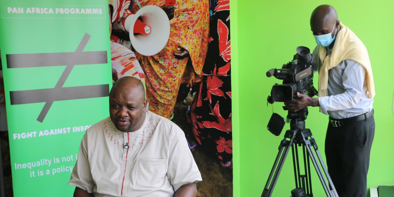 Oxfam Pan Africa Program Director Peter Kamalingin B.L speaking to journalists on October 8, 2020.