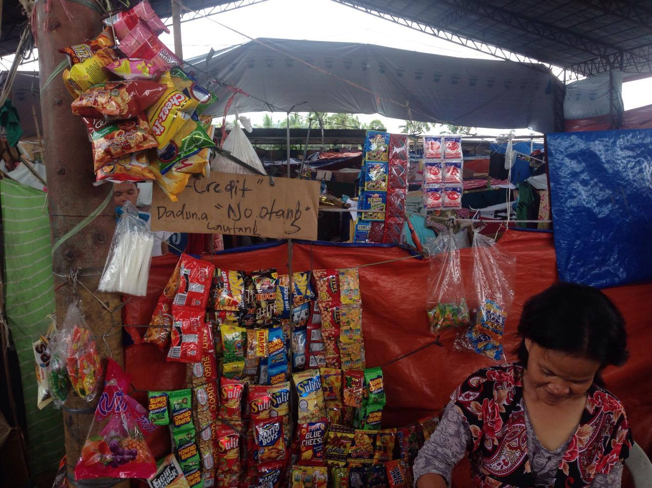 A woman evacuee from Marawi City started a small shop inside the Saguiaran evacuation center