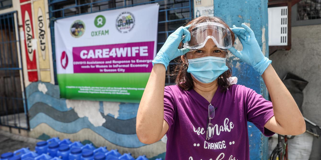 Elizabeth Asanion, 45, wears her protective goggles during a relief operation in partnership with Oxfam Philippines titled Care4Wife: COVID-19 Assistance and Response to Emergency Needs for Women in Informal Economy in Namapa Compound, Barangay North Fairview in Quezon City, Metro Manila, Philippines. PHOTO: Basilio Sepe/Oxfam