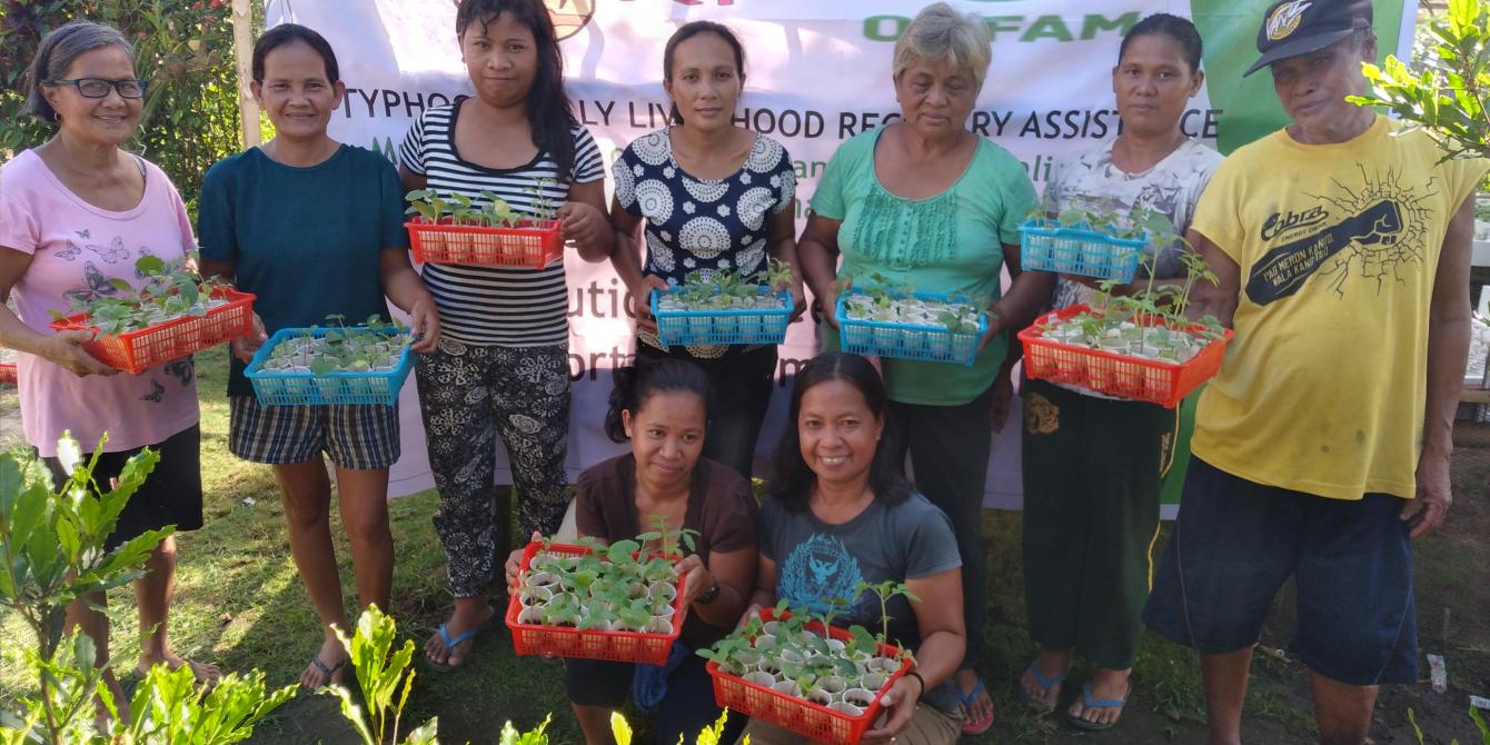 Residents of Typhoon Rolly-hit communities in Camarines Sur work together to care for vegetable seedlings nurseries as part of Rice Watch Action Network, Inc. assistance. (Photo: RWAN)