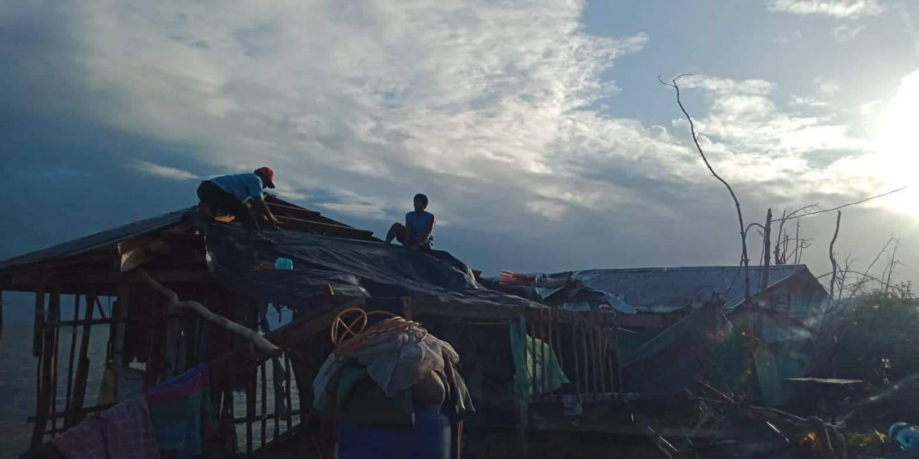 Fisherfolk from Palanas village in Salcedo, Eastern Samar, attempt to repair their damaged homes with tarpaulins a day after Christmas. Typhon Ursula first made landfall in Salcedo on December 24.  Photo credit: Charita Llanera/PDRRN