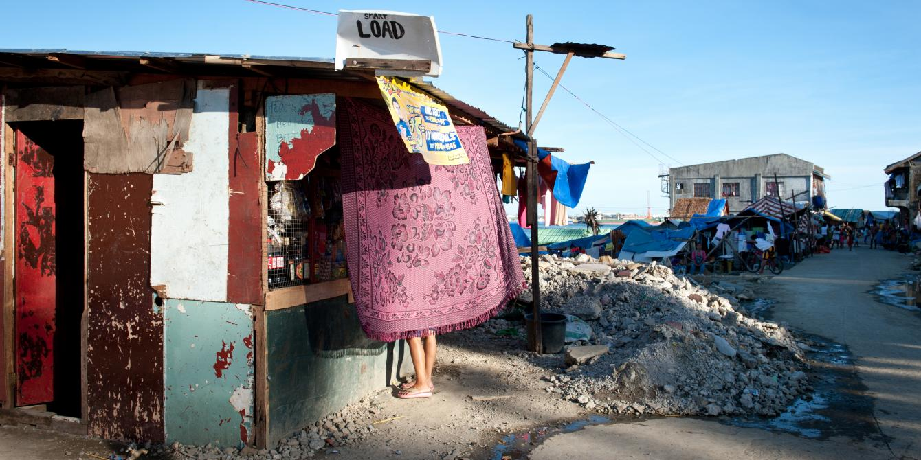 Shops and small stores are opening three months after Typhoon Haiyan. In a badly-hit part of Tacloban, a shop offering phone credit has already been built and is well stocked.(Photo: Eleanor Farmer/Oxfam)