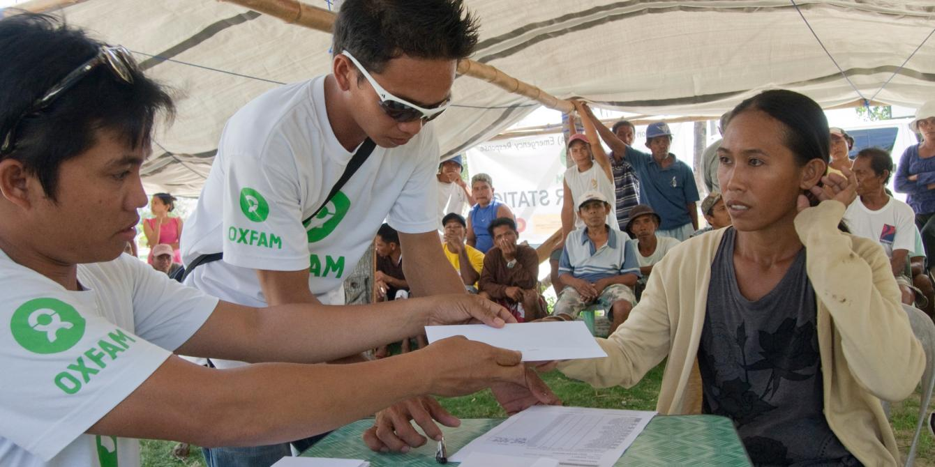 Oxfam has been helping fisherfolk on the island get back on their feet with its boat repair programme. In Sulangan village the first group of 58 people are receiving up to 6,000 pesos each ($134, £80) to fix their damaged boats. (Photo: Caroline Gluck/Oxfam)
