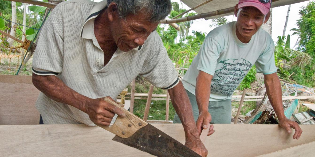Local carpenters working at an Oxfam Boat Rebuilding Station.(Photo: Caroline Gluck/Oxfam)