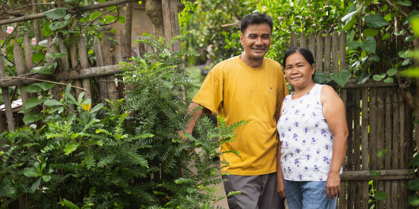 A portrait of Johnny and Juanita Paz outside their house in Datu Abdullah Sangki, Maguindanao. (Photo: Princess Taroza/Oxfam)