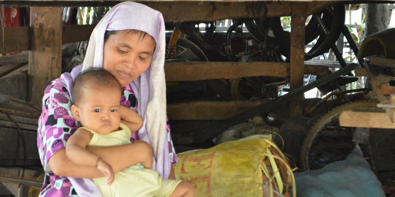 Tanumbay, 22, from Maguindanao got married at age 10 to a man 20 years older than her. 'I didn't want to marry, but I had no choice. It was my father's wish before he died,' she said. Tanumbay was 12 years old when she gave birth to her eldest son. Now, she has five children. Tanumbay never experienced going to school because of poverty. Photo: April Abello-Bulanadi/Oxfam