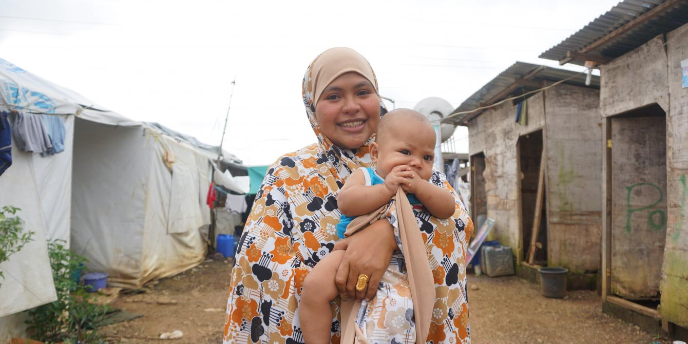 Esni Haya, pictured here holding her four-month-old baby, has been living in the Sarimanok Evacuation Center for more than two years since the Marawi Siege. She shared with us her experiences of displacement; the challenges evacuees face in accessing WASH and other basic facilities; and her dreams of homecoming. Oxfam led the initial case study research in the three major island groups of the Philippines to co-create a shared understanding of context-specific issues that must be included in policy developme